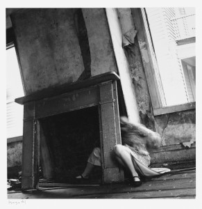 Eating the darkness songwriting inspiration Francesca Woodman peeling wallpaper fireplace empty room abandoned house self-portrait