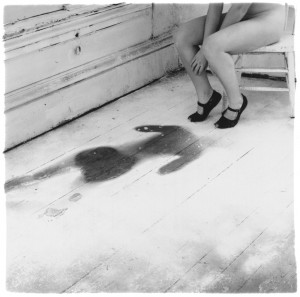 Eating the darkness songwriting inspiration Francesca Woodman body print black shoes woman floorboards empty room abandoned house self-portrait