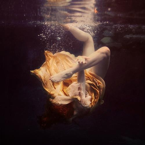goldfish woman drowning under water bubbles orange dress yellow fabric art photography photo