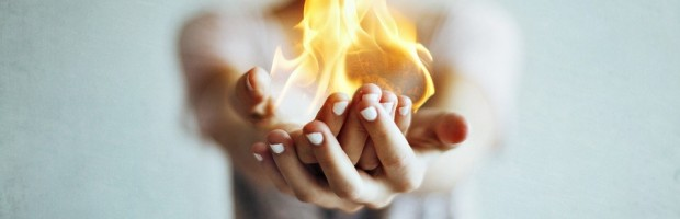 Photographer-unknown_Woman-holding-flame-in-cupped-hands