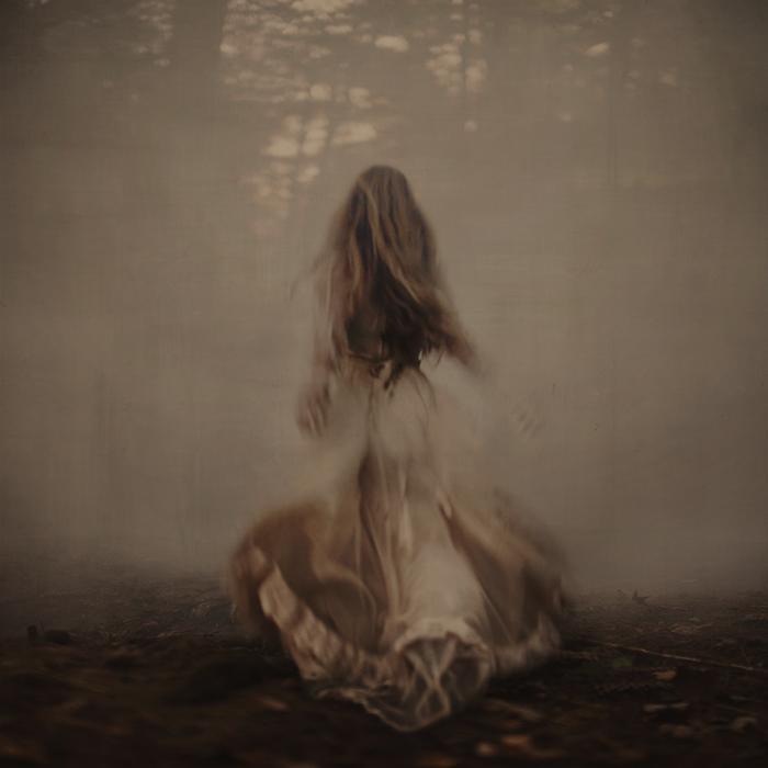 Brooke Shaden Chasing woman dress fog evaporated