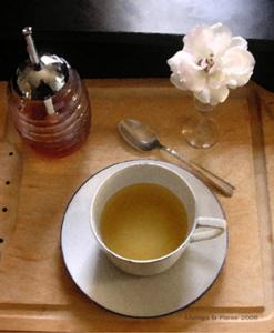 tea cup tea honey in jar white flower