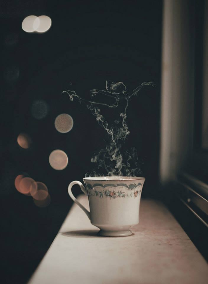 cup of tea steam in the shape of a dancer window sill night stars